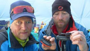 Climber Andy Holzer and Klemens Bichler holding CEECOACH in their hands