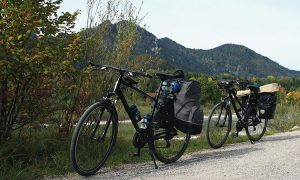 Two bikes with panniers on a gravel road