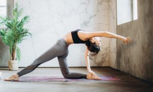 The image shows a woman doing yoga